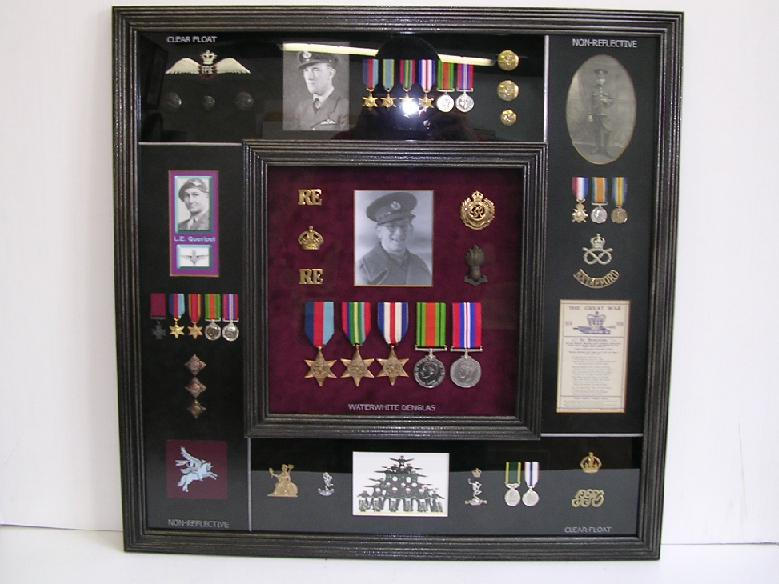 Collection of medals, photographs and badges