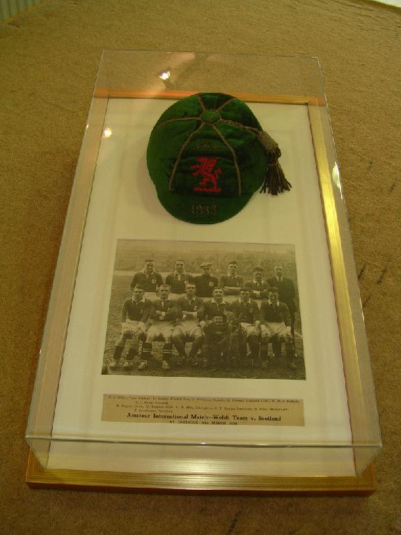 School Cap and photo in a perspex box with frame