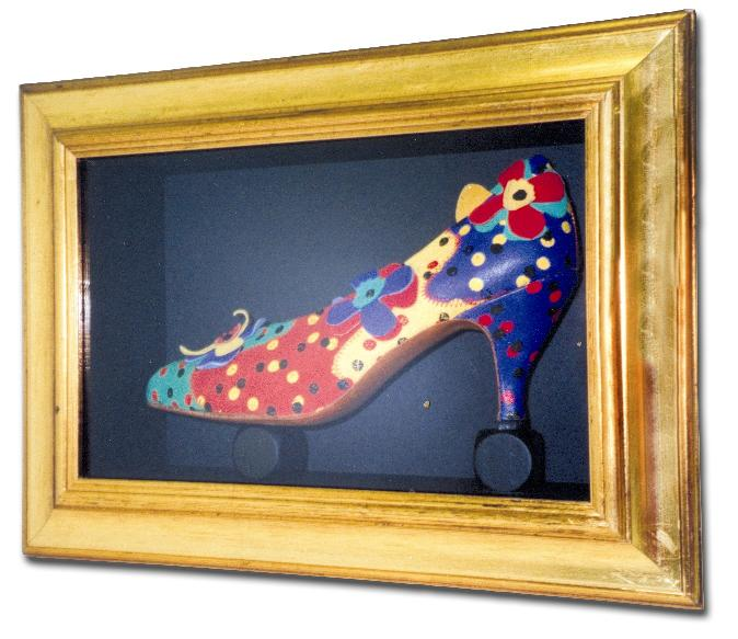 A shoe, framed in a deep box frame